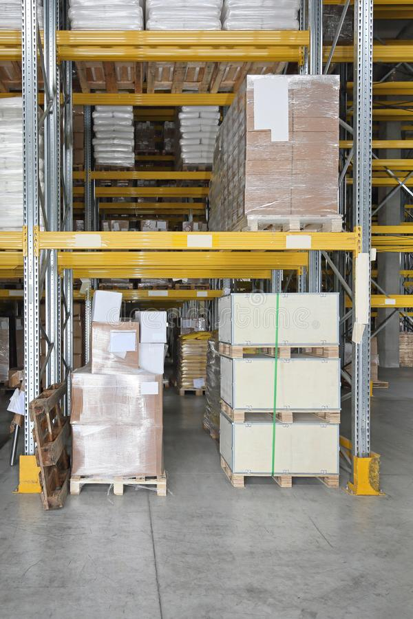Warehouse Shelf. Pallets and Boxes at Shelves in Distribution Warehouse royalty free stock photos