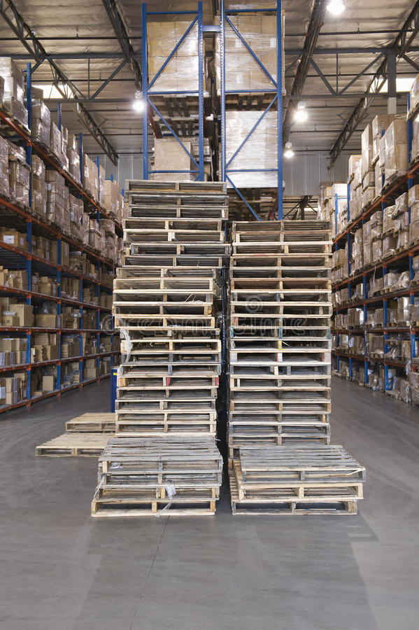 Pallets And Boxes Stacked In Warehouse stock photos