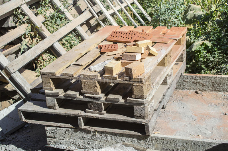 Pallets and remaining balance of a brick stock images