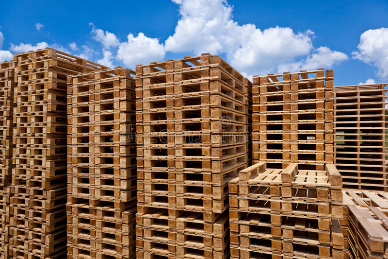 Pallets. Stacked pallets, symbolic photo for freight transport and logistics royalty free stock image