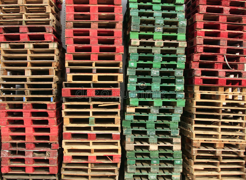 Pallets. Stacks of color coded pallets royalty free stock image