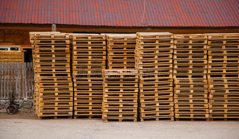 Pallets. Wooden pallets near the warehouse, exactly stacked royalty free stock images