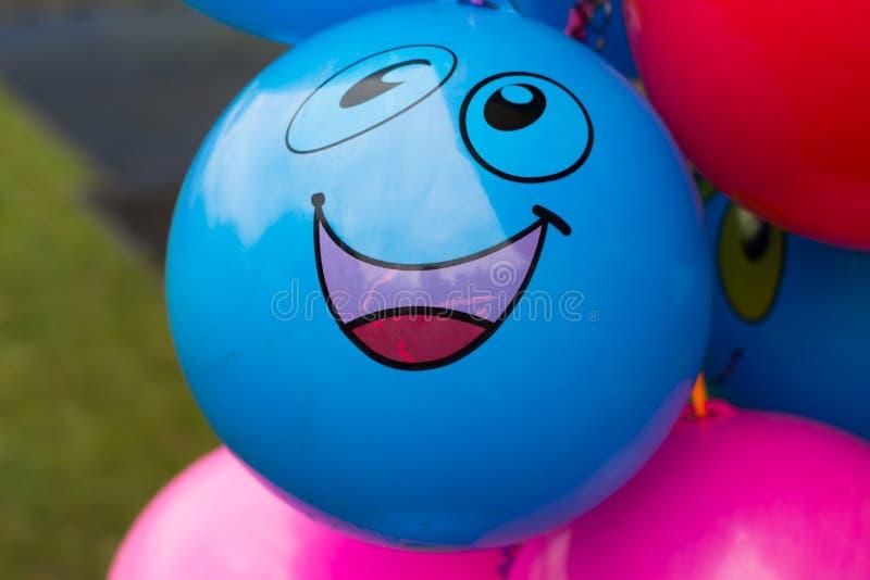 Palloni con il fronte sorridente immagine stock libera da diritti