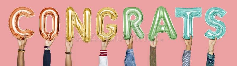Palloni variopinti di alfabeto che formano i congrats di parola fotografia stock libera da diritti