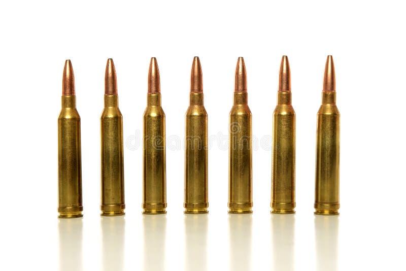 Pallottole nella linea fotografia stock
