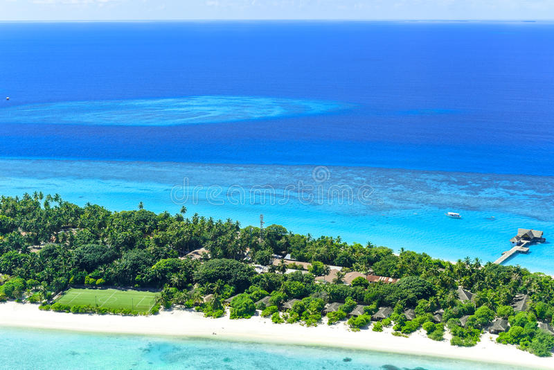 Palm Beach Resort & Spa Maldives in Lhaviyani Atoll. Palm Beach Resort is one of the most beautiful island resorts in the Maldives. The island is surrounded by a royalty free stock image