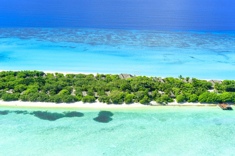 Palm Beach Resort & Spa Maldives in Lhaviyani Atoll. Palm Beach Resort is one of the most beautiful island resorts in the Maldives. The island is surrounded by a stock photo