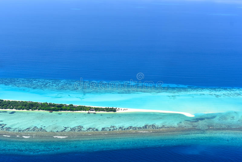 Palm Beach Resort & Spa Maldives. Palm Beach Resort is one of the most beautiful island resorts in the Maldives. The island is surrounded by a 3-mile white royalty free stock photography