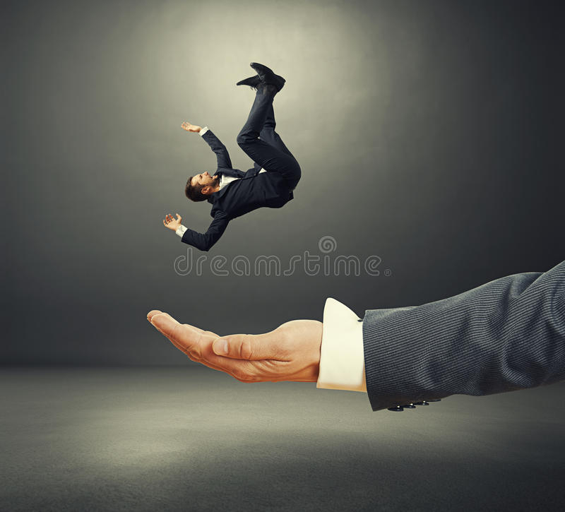 Free Palm Catching Small Startled Businessman Royalty Free Stock Image - 44296536