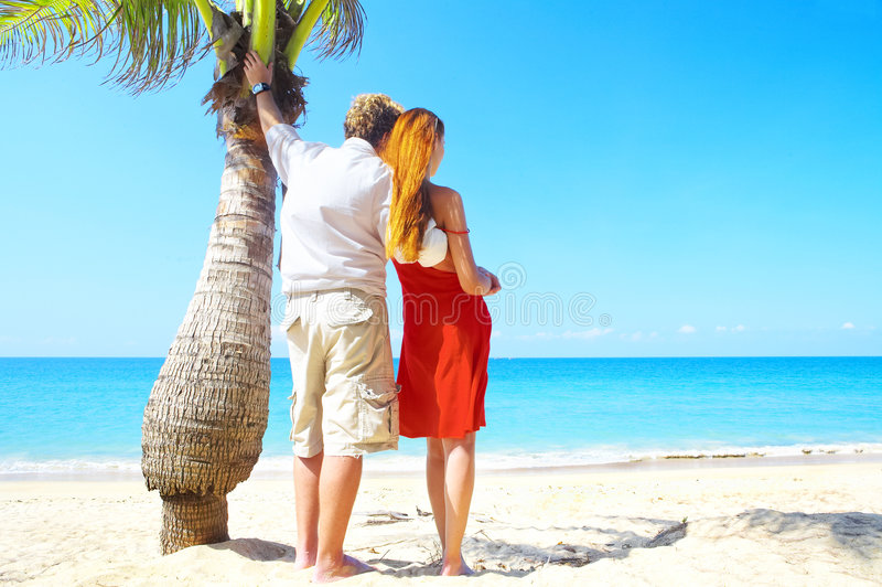 Palm And Couple Royalty Free Stock Image