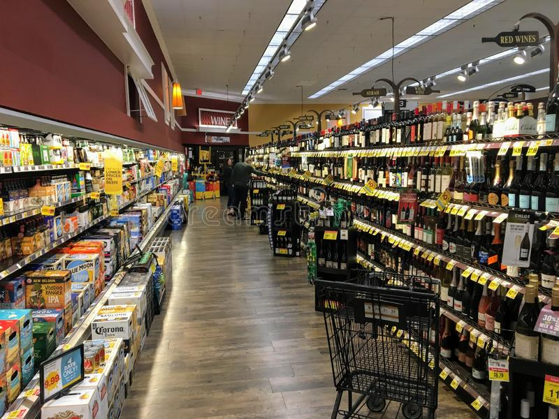 A grocery store aisle stocked with endless options of wine and beer in Palm Desert, California, United States. Palm Desert, United States - January 25th, 2019: A royalty free stock photo