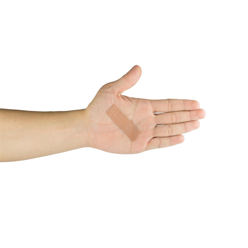 Palm and fingers with adhesive bandage, isolated on white background royalty free stock photo