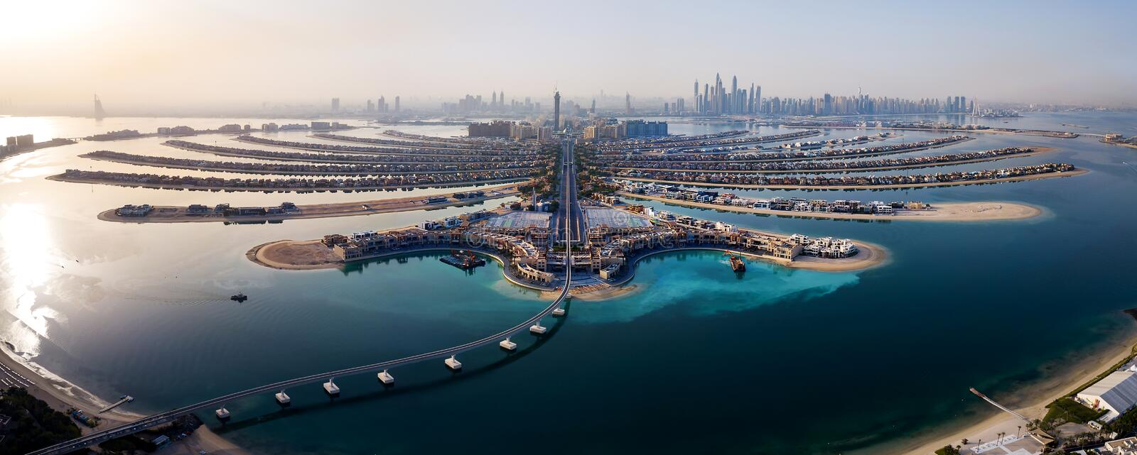 The Palm island panorama with Dubai marina in the background aerial stock photography