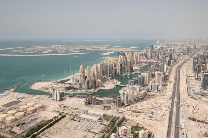 Palm Island & Waterfront Buildings. The Palm Island in the sea & Waterfront Properties Along Sheikh Zayed Road In Dubai stock photography