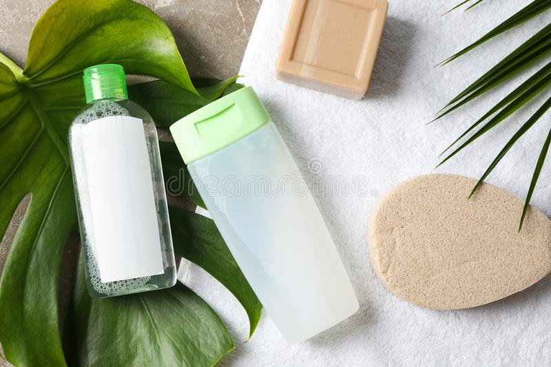 Palm leaves, soap, sponge, shower gel, shampoo and towel. Top view royalty free stock photo