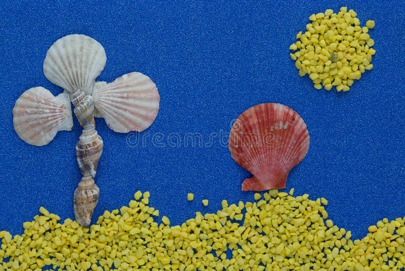 Summer composition with shells on blue glitter background royalty free stock photography