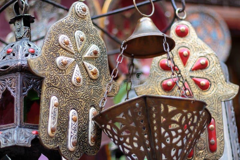 Palm shaped amulets hand of Fatima stock photography
