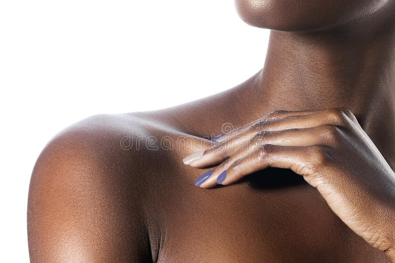 Palm on shoulder of young beautiful black woman with clean perfect skin royalty free stock images