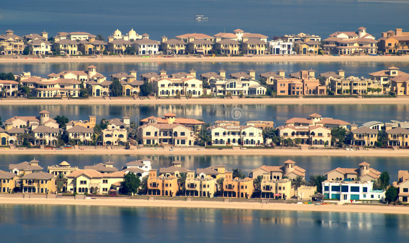 Palm. Spacious villas of different styles make up the charme of the fronds of the Palm Jumeirah in Dubai royalty free stock photo