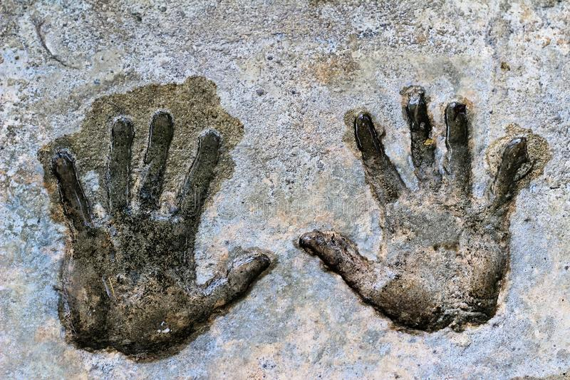 The palm is stamped. On the cement floor stock photography