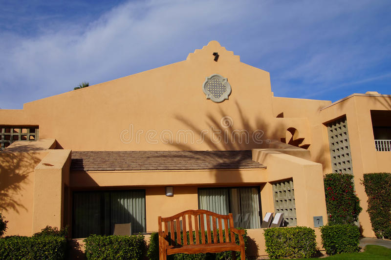 Palm tree and Southwestern architecture stock image