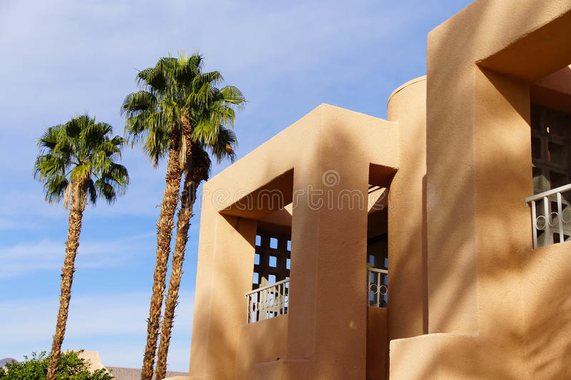 Palm tree and Southwestern architecture stock images