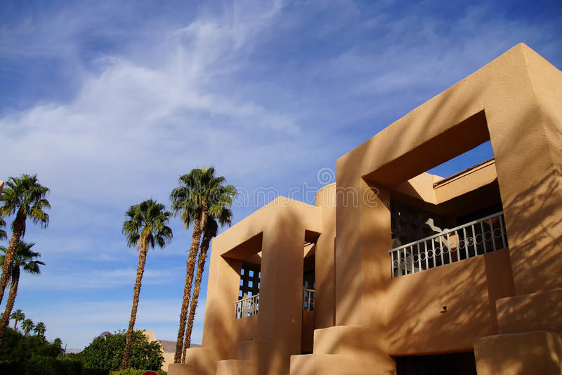 Palm tree and Southwestern architecture royalty free stock images