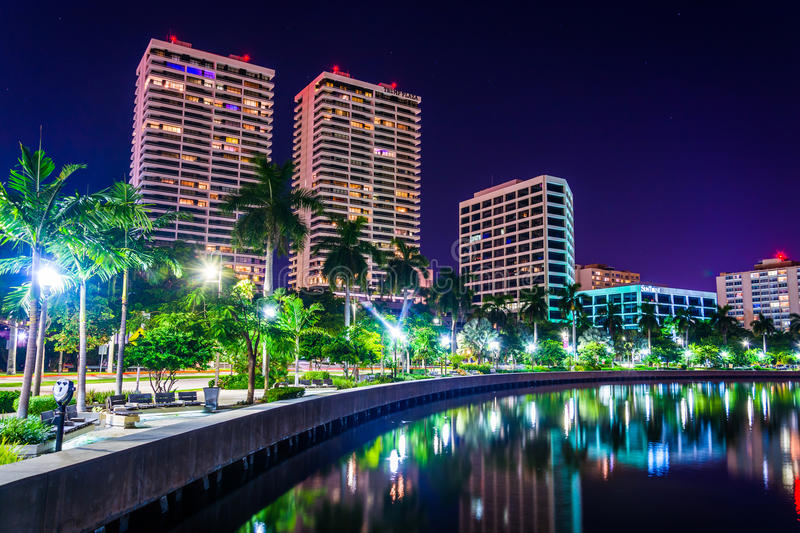 Palm trees along the Intracoastal Waterway and the skyline at ni. Ght in West Palm Beach, Florida royalty free stock photography