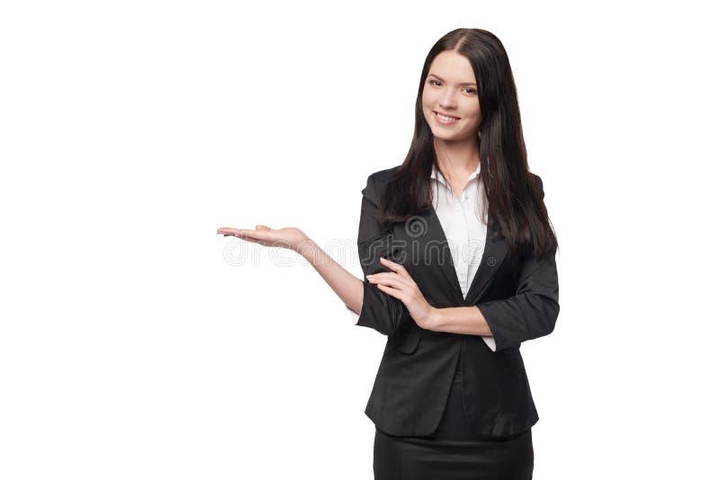 Palma abierta de la mano de la demostración de la mujer de negocios imagenes de archivo
