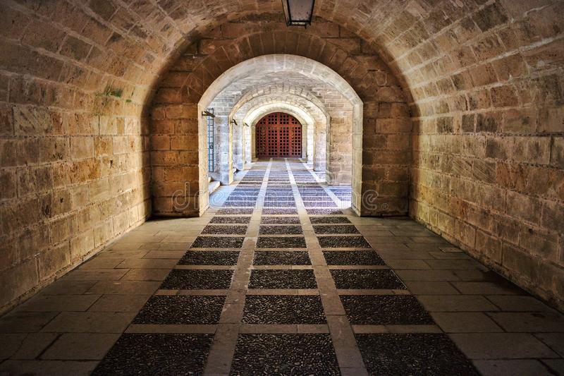 Palma cathedral ancient brick passageway with arches and iron gate, mallorca, spain royalty free stock photo
