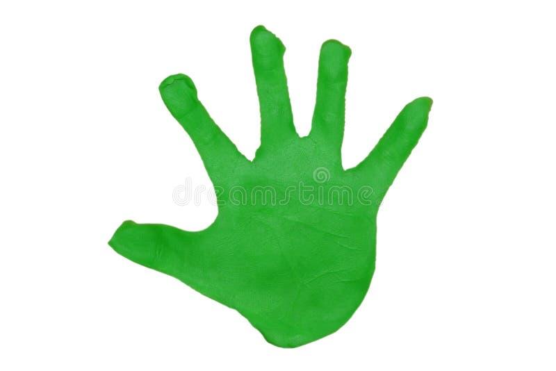 Palma das crianças do plasticine verde imagens de stock royalty free