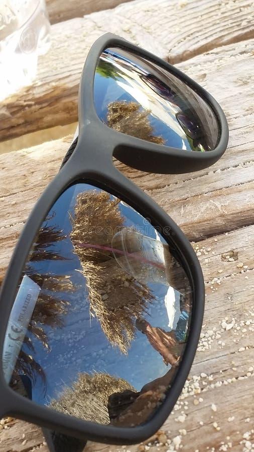 Palma de la arena de los vidrios fotos de archivo