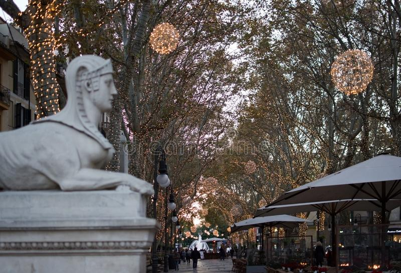 Sfinx at Passeig des Born. PALMA DE MALLORCA, BALEARIC ISLANDS, SPAIN - DECEMBER 5, 2017: Sfinx at Passeig des Born with evening Christmas light decorations on royalty free stock photography