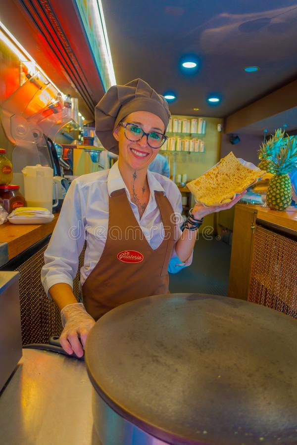 PALMA DE MALLORCA, SPAIN - AUGUST 18 2017: Close up of unidentified woman, holding in her hand a crepe, cooked on an stock images