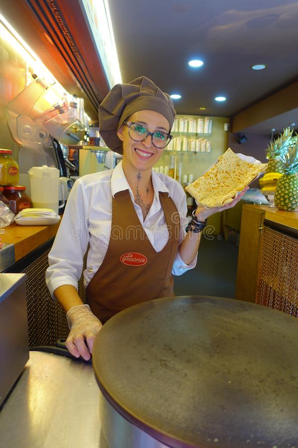 PALMA DE MALLORCA, SPAIN - AUGUST 18 2017: Close up of unidentified woman, holding in her hand a crepe, cooked on an royalty free stock photo