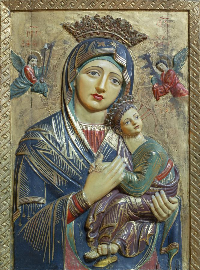 PALMA DE MALLORCA, SPAIN - JANUARY 26, 2019: The carved polychrome relief of Madonna Our Lady of Perpetual Help in church stock photo