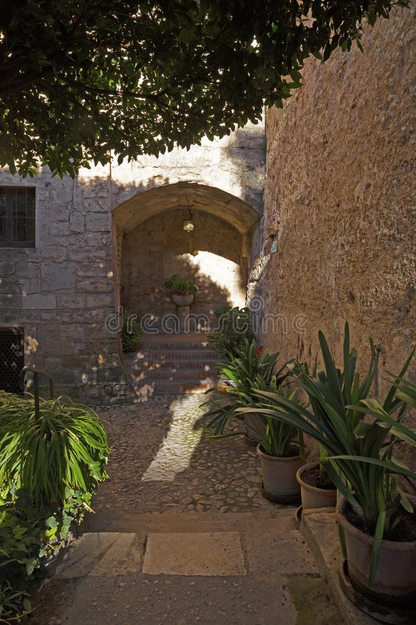 PALMA DE MALLORCA, SPAIN - JANUARY 27, 2019: The little medieval external patio of Banos arabes of the cathedral.  stock image