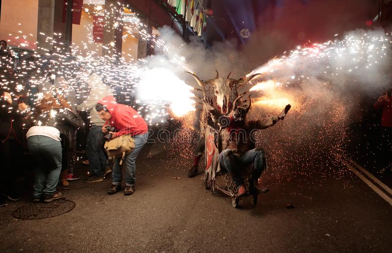 Correfoc in palma at saint sebastian local patron festivities. Palma de Mallorca, Spain, January 21st, 2018. Revellers dressed as devils and holding fireworks stock photography