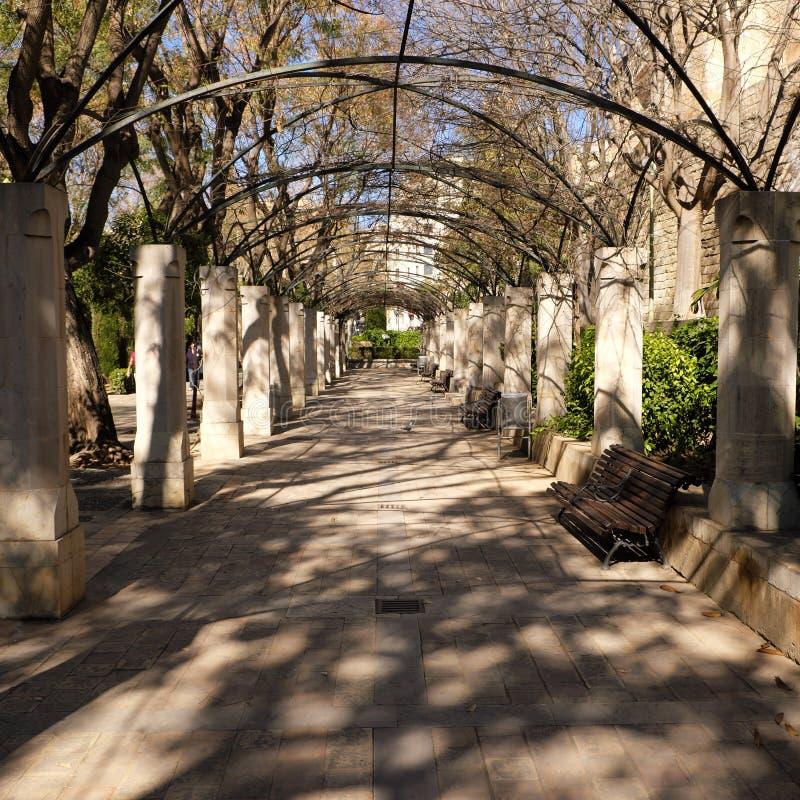 Palma Mallorca almudaina kings palace garden arch park. Palma Mallorca almudaina kings palace garden arch  walkway passage stock image