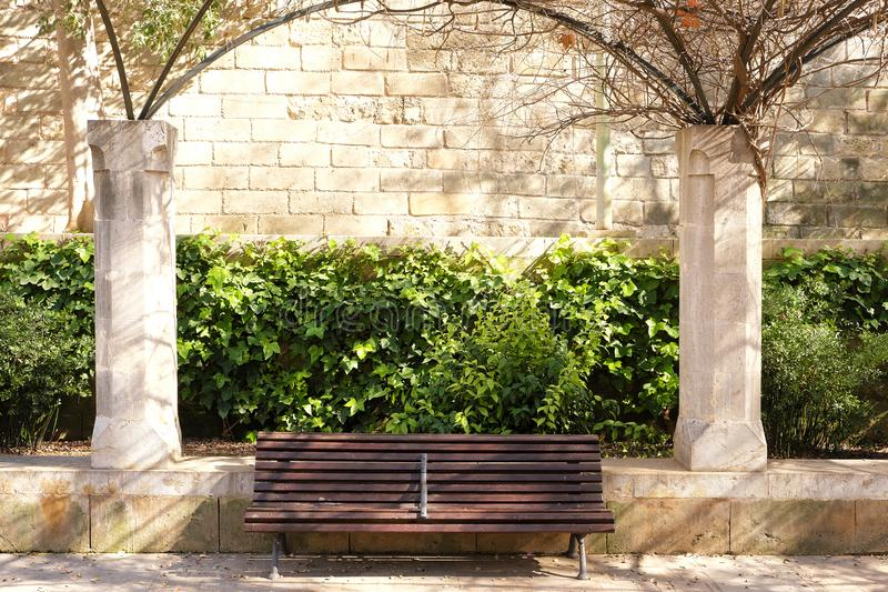Palma Mallorca almudaina kings palace garden park bench scene. Palma Mallorca almudaina kings palace garden park bench royalty free stock image