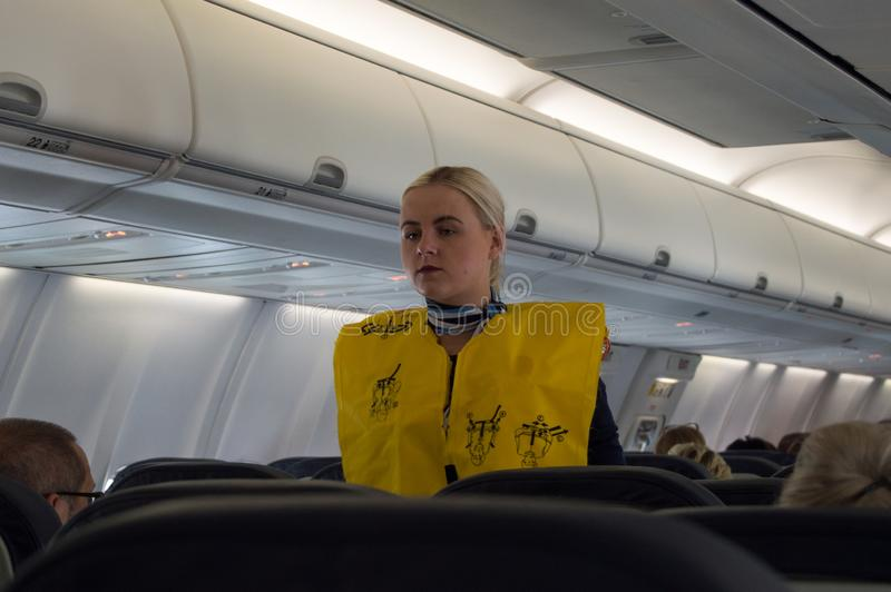 Palma, Spain - Avril 05, 2019: Stewardesses in the cabin of the Boeing 737-800 passenger airplane instructs passengers royalty free stock image