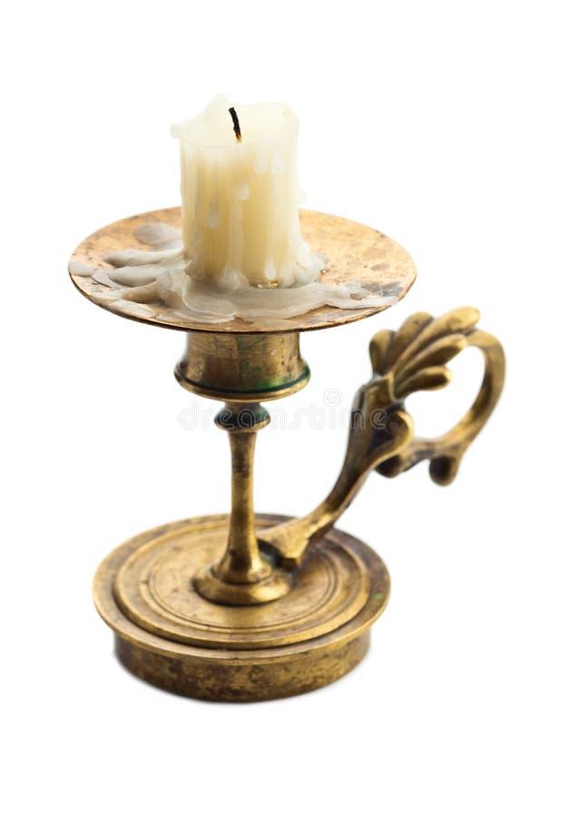 Palmatoria con la vela aislada en blanco imágenes de archivo libres de regalías