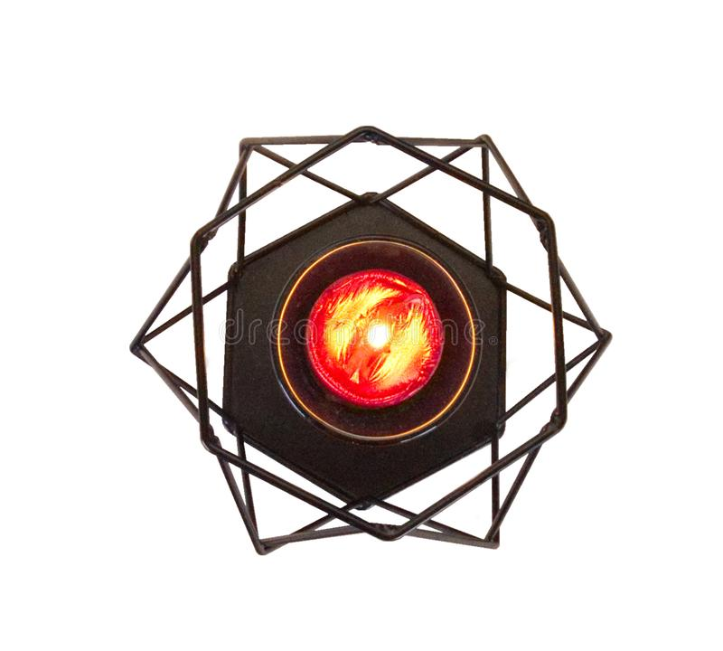 Palmatoria negra con una vela roja, aislada en el fondo blanco del top fotos de archivo