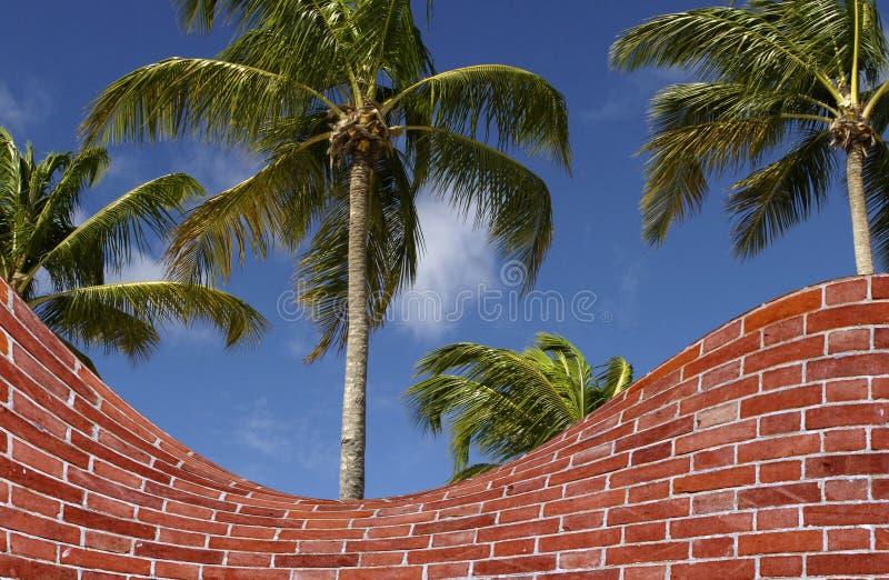 Palme- und Backsteinmauerfälschung stockfoto