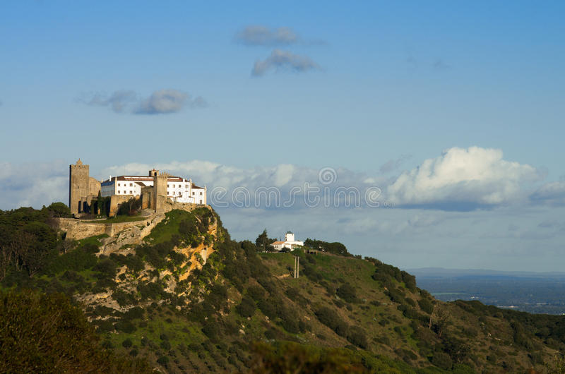 Palmela castle on top of the hill, under blue sky. Portugal stock photos
