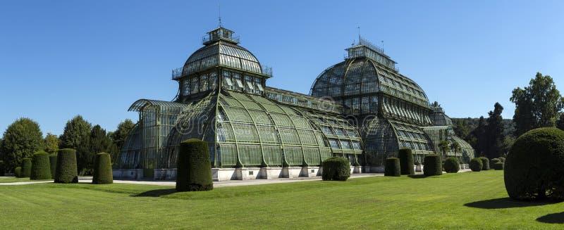 Palmenhaus pavilion greenhouse in garden of Schloss Schonbrunn palace, Vienna, Austria. Schonbr. Unn Palace is former imperial summer residence located Vienna stock photos