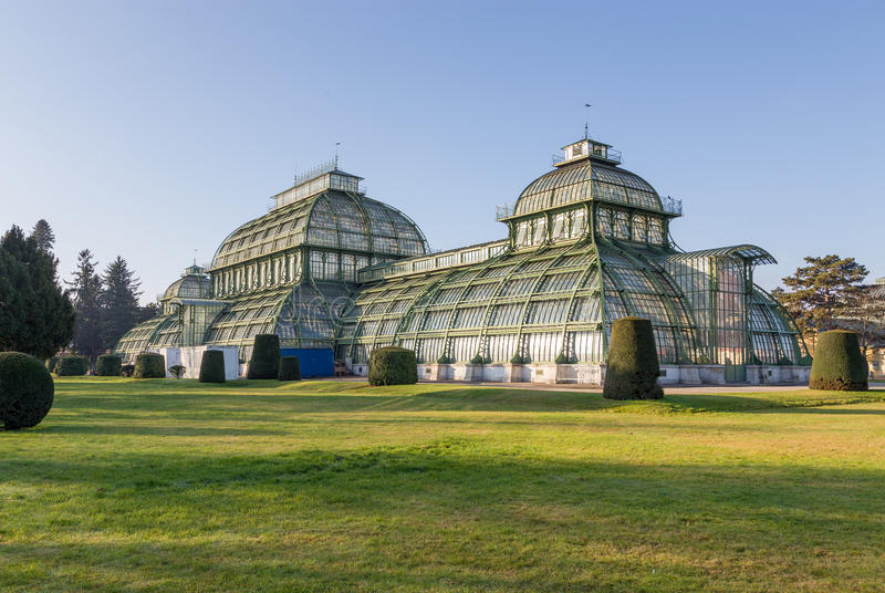The Palmenhaus in Schonbrunn Palace Park, Vienna, Austria. The Palmenhaus Schonbrunn is a large greenhouse in Vienna, Austria, featuring plants from around the royalty free stock images