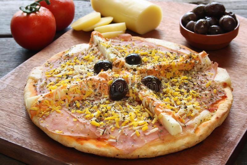 Palmetto pizza. With two glasses of beer and ingredients royalty free stock photo