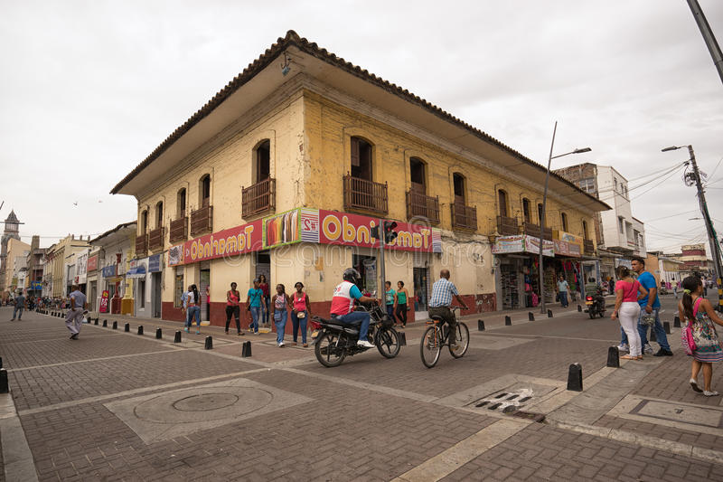 Palmira Colombia srtreet view. July 10, 2017 Palmira, Valle de Cauca, Colombia: men riding bicycle and motorbike pass on the street of the town with one of the stock images