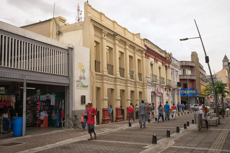 Palmira Valle de Cauca Colombia city centre area. July 10, 2017 Palmira, Valle de Cauca, Colombia: men pass on the street of the town with one of the highest royalty free stock photography